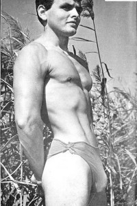 Male vintage physique photography outdoors.